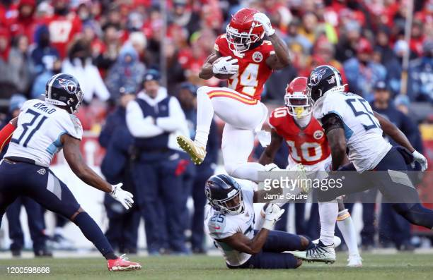 Darwin Thompson of the Kansas City Chiefs runs with the ball and jumps over Adoree' Jackson of the Tennessee Titans in the second half in the AFC...