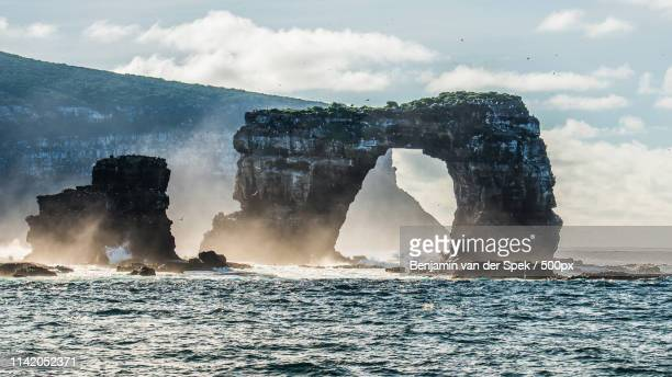 darwin's arch - darwin island stock photos and pictures