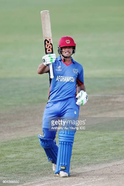 Darwish Rasooli of Afghanistan celebrates scoring a half century during the ICC U19 Cricket World Cup match between Pakistan and Afghanistan at...