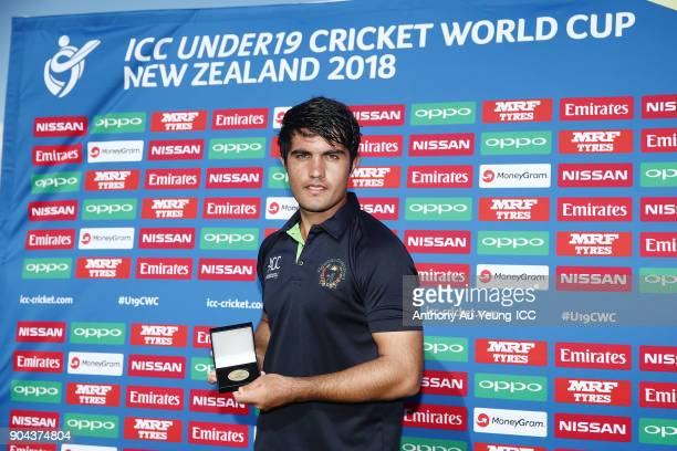Darwish Rasooli of Afghanistan poses for a photo with the Man of the Match medallion after the ICC U19 Cricket World Cup match between Pakistan and...