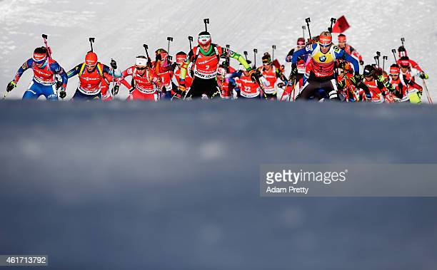 Darya Domracheva of Belarus and Kaisa Makarainen of Finland lead the pack during the IBU Biathlon World Cup Women's Mass Start on January 18 2015 in...