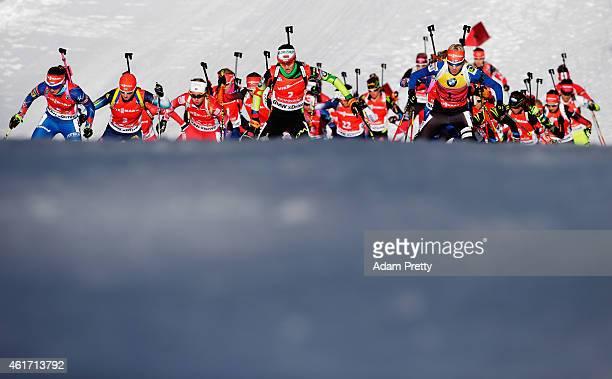 Darya Domracheva of Belarus and Kaisa Makarainen of Finland lead the pack during the IBU Biathlon World Cup Women's Mass Start on January 18, 2015 in...