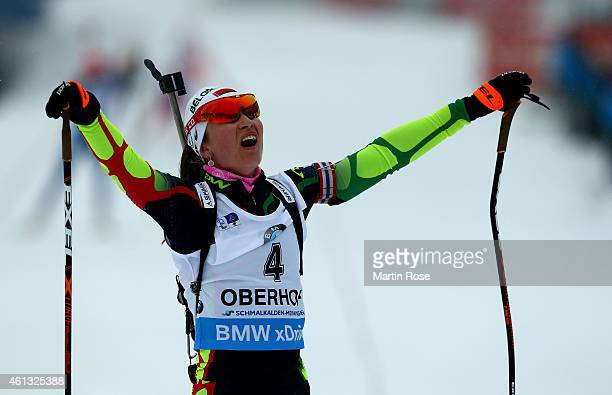 Darya Domracheva of Belarus celebrate after crossing the finish line during the Women's 12.5 km mass start of the BMW World Cup on January 11, 2015...