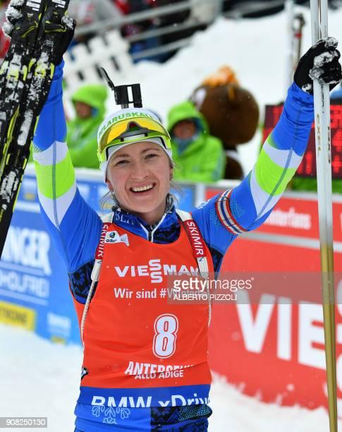 Darya Domracheva of Belarus celebrates after winning the Women's 12.5 km Mass Start Competition of the IBU World Cup Biathlon in Anterselva on...