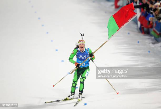 Darya Domracheva of Belarus celebrates as she appraoches the line to win gold during the Women's 4x6km Relay on day 13 of the PyeongChang 2018 Winter...