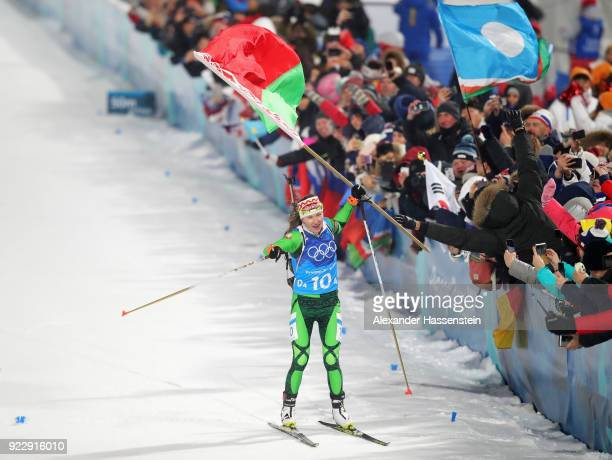 Darya Domracheva of Belarus celebrates as she approaches the finish line to win gold during the Women's 4x6km Relay on day 13 of the PyeongChang 2018...