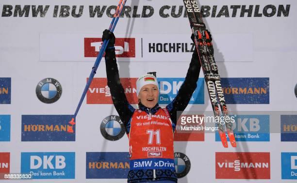 Darya Domracheva of Belarus celebrates on the podium after winning the 7.5 km Women's Sprint during the BMW IBU World Cup Biathlon on December 8,...