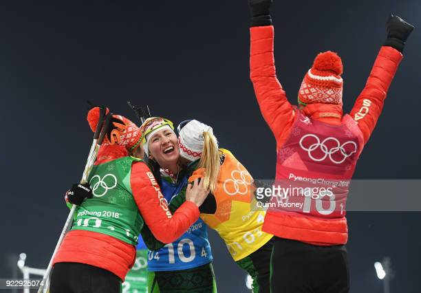 Darya Domracheva of Belarus celebrates winning gold with Iryna Kryuko Dzinara Alimbekava and Nadezhda Skardino of Belarus during the Women's 4x6km...