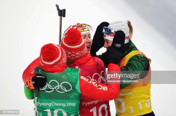 Darya Domracheva of Belarus celebrates winning gold with Iryna Kryuko Dzinara Alimbekava and Nadezhda Skardino of Belarus during the Women's 4x6km...
