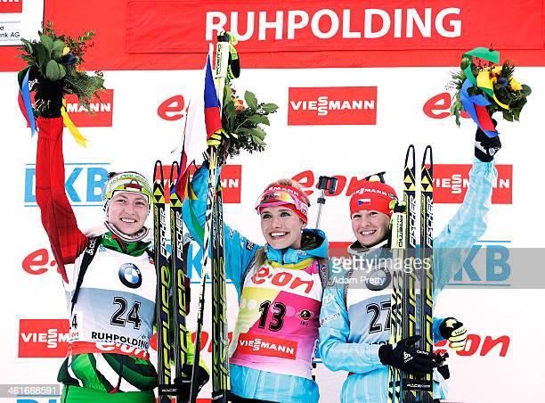 Darya Domracheva of Belarus, Gabriela Soukalova of the Czech Republic and Veronika Vitkova of the Czech Republic celebrate during the flower ceremony...
