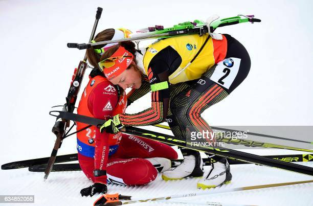 Darya Domracheva of Belarus is congratuled by Laura Dahlmeier of Germany after the Women's 10 km pursuit race during the 2017 IBU World Championships...