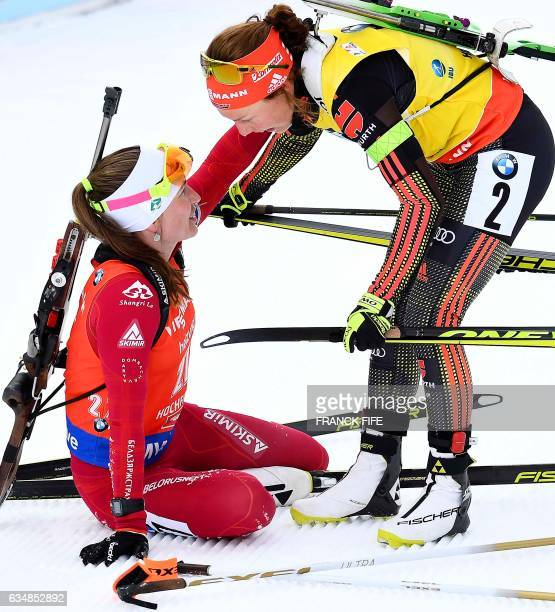 Darya Domracheva of Belarus is congratuled by Laura Dahlmeier of Germany after the women's 10km pursuit competition during the 2017 IBU World...