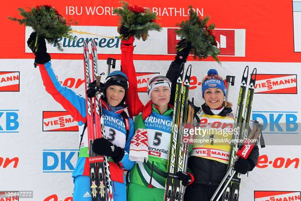 Darya Domracheva of Belarus takes 1st place, Olga Zaitseva of Russia takes 2nd place, Magdalena Neuner of Germany takes 3rd place during the IBU...