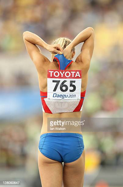 Darya Klishina of Russia adjust her kit at the end of the runway in the women's Long Jump final during day two of 13th IAAF World Athletics...