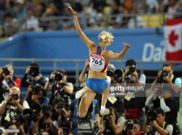 Darya Klishina of Russia competes in front of the cameras in the women's long jump final during day two of the 13th IAAF World Athletics...