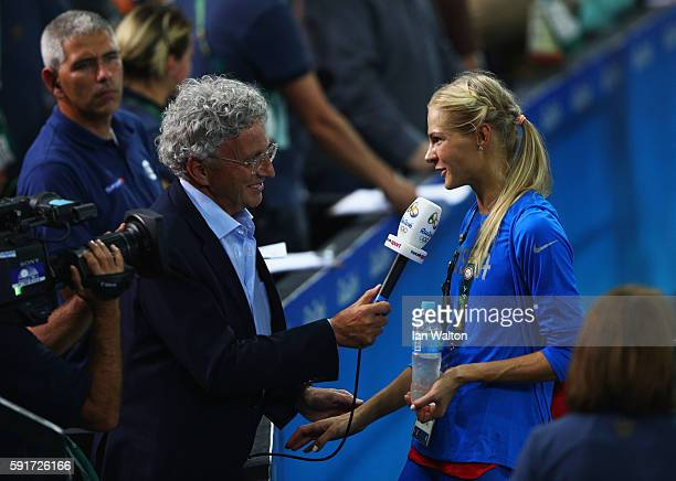 Darya Klishina of Russia is interviewed after the Women's Long Jump final on Day 12 of the Rio 2016 Olympic Games at the Olympic Stadium on August 17...