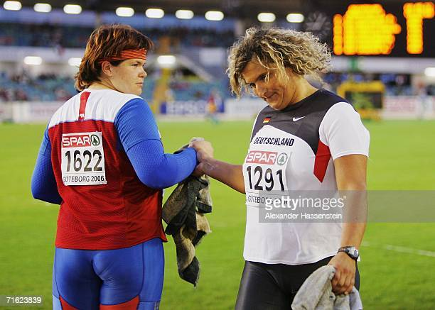 Darya Pishchalnikova of Russia and Franka Dietzsch of Germany shake hands during the Women's Discus throw Final on day four of the 19th European...