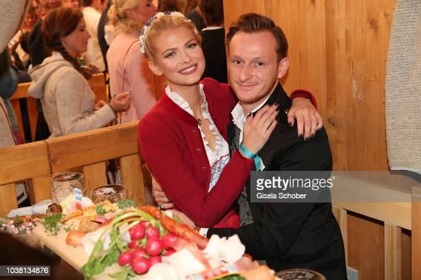 Darya Strelnikova and her boyfriend Roger Steininger during the 'Fruehstueck bei Tiffany' at Schuetzenfestzelt at the Oktoberfest on September 22...