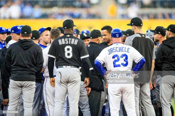 Daryl Boston of the Chicago White Sox and Mike Jirschele of the Kansas City Royals watch their teams after the benches cleared during the first...