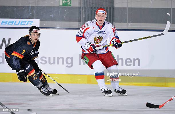 Daryl Boyle and Evgeny Kuznetsov during a Euro Hockey Challenge game on April 24 2014 in Munich Germany