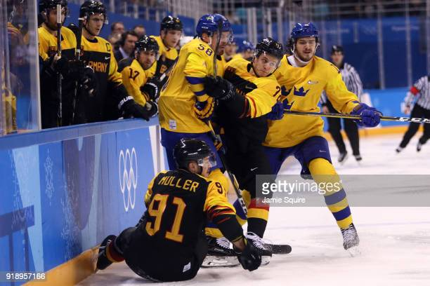 Daryl Boyle of Germany skates against Anton Lander of Sweden during the Men's Ice Hockey Preliminary Round Group B game at Gangneung Hockey Centre on...