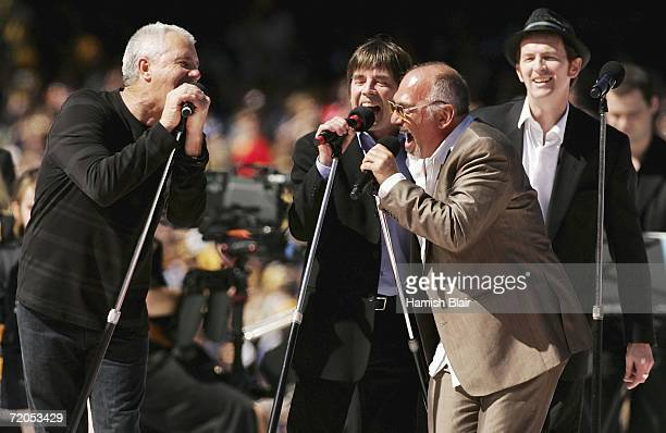 Daryl Braithwaite John Paul Young and Joe Camilleri perform as part of the pre match entertainment before the AFL Grand Final match between the...