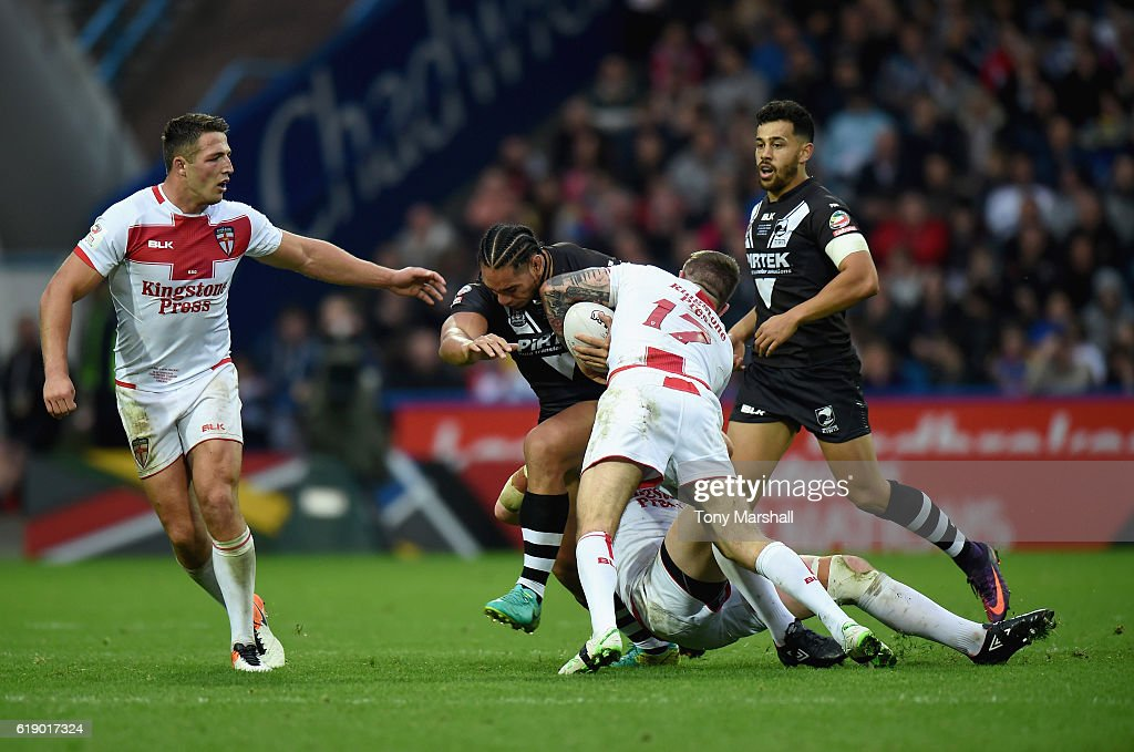 Daryl Clark and James Graham of England tackle Martin Taupau of New Zealand Kiwis during the Four Nations match between the England and New Zealand Kiwis at the John Smith's Stadium on October 29, 2016 in Huddersfield, United Kingdom.