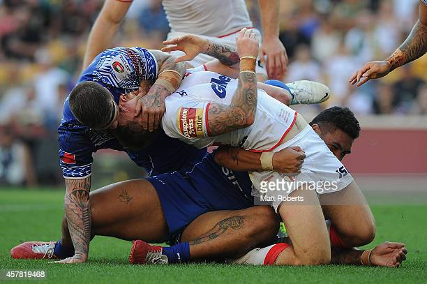 Daryl Clark of England is tackled during the Four Nations match between England and Samoa at Suncorp Stadium on October 25 2014 in Brisbane Australia
