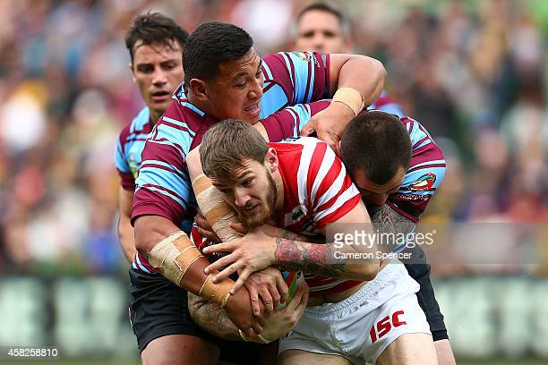 Daryl Clark of England is tackled during the Four Nations match between the Australian Kangaroos and England at AAMI Park on November 2 2014 in...