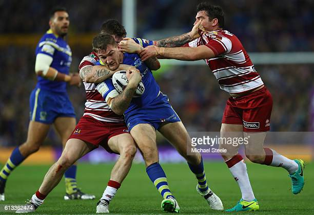 Daryl Clark of Warrington cuts between John Bateman and Matty Smith of Wigan during the First Utility Super League Final between Warrington Wolves...
