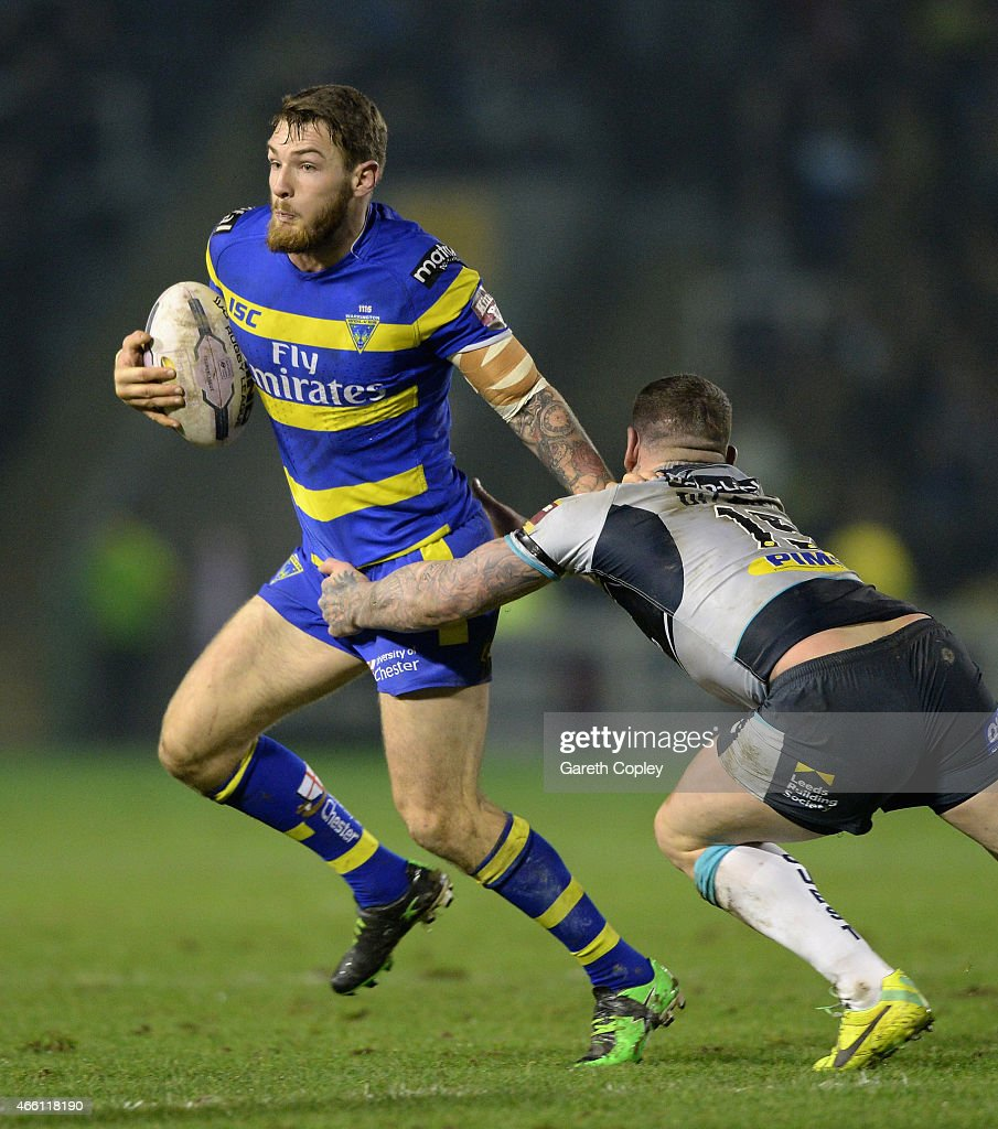 Daryl Clark of Warrington Wolves gets past Brett Delaney of Leeds Rhinos during the First Utility Super League match between Warrington Wolves and Leeds Rhinos at The Halliwell Jones Stadium on March 13, 2015 in Warrington, England.