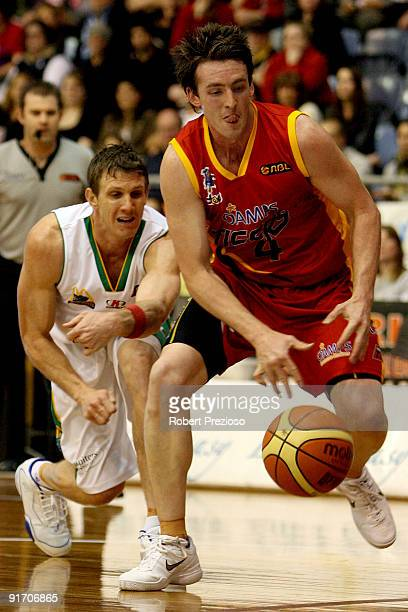 Daryl Corletto of the Tigers drives to the basket during the round three NBL match between the Melbourne Tigers and the Townsville Crocodiles on...