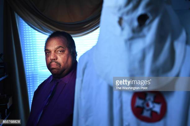 Daryl Davis poses for a portrait at his home with a Ku Klux Klan hood and robe in the foreground on Thursday September 28 2017 in Silver Spring MD...