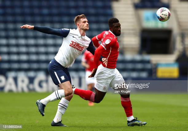 Daryl Dike of Barnsley battles with Liam Lindsay of Preston North End during the Sky Bet Championship match between Preston North End and Barnsley at...