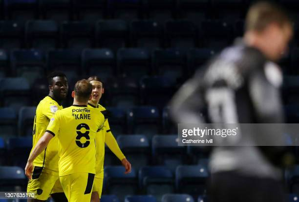Daryl Dike of Barnsley FC celebrates with Herbie Kane after scoring their team's third goal during the Sky Bet Championship match between Wycombe...