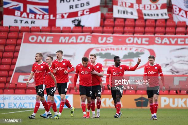 Daryl Dike of Barnsley FC celebrates with teammates after scoring their team's first goal during the Sky Bet Championship match between Barnsley and...