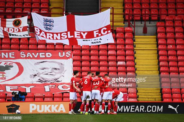 Daryl Dike of Barnsley FC celebrates with teammates after scoring their team's second goal during the Sky Bet Championship match between Barnsley and...