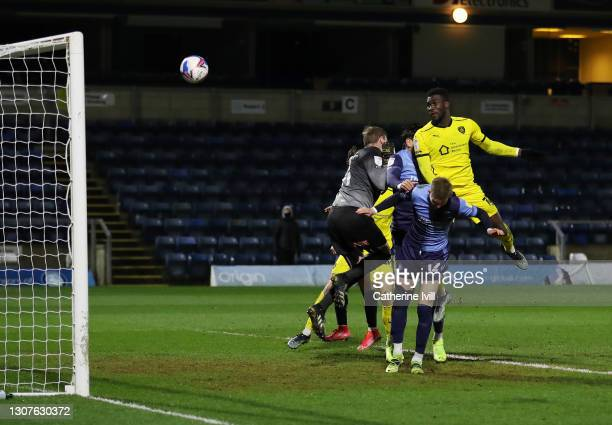Daryl Dike of Barnsley FC scores their team's second goal past David Stockdale of Wycombe Wanderers during the Sky Bet Championship match between...