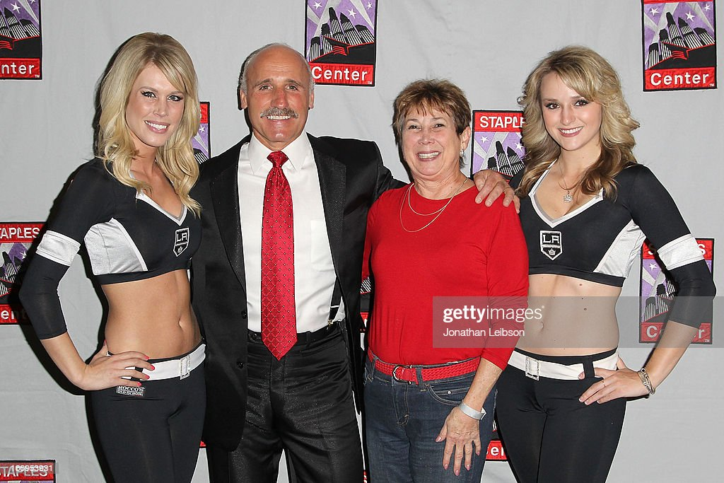 Daryl Evans (L) and The LA Kings Ice Crew pose with guest at the LA Kings Chalk Talk & Game Experience at Staples Center on April 18, 2013 in Los Angeles, California.