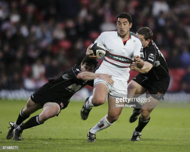 Daryl Gibson of Leicester races past Kevin Sorrell and Ben Johnston during the Guinness Premiership match between Saracens and Leicester Tigers at...