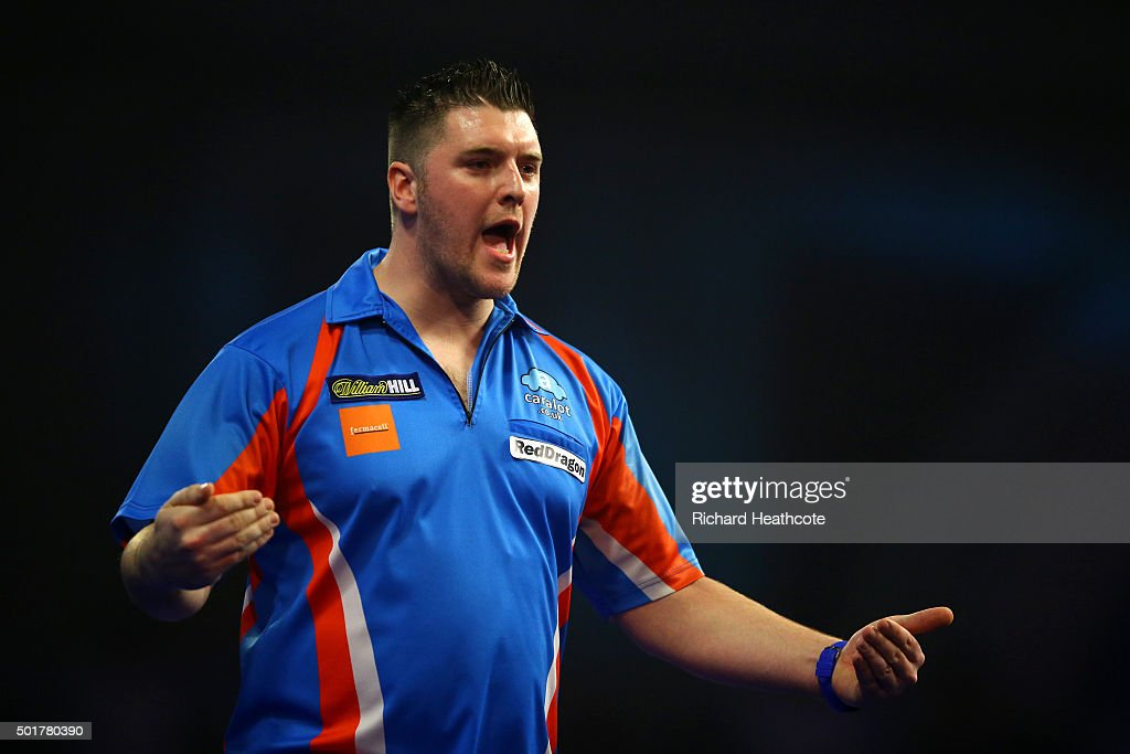 Daryl Gurney celebrates victory over Jamie Lewis during the first round on day one of the 2016 William Hill PDC World Darts Championships at Alexandra Palace on December 17, 2015 in London, England.