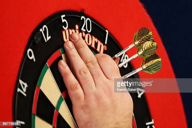 Daryl Gurney of Northern Ireland collects his darts during the second round match against John Henderson of Scotland on day ten of the 2018 William...