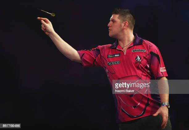 Daryl Gurney of Northern Ireland in action during the second round match against John Henderson of Scotland on day ten of the 2018 William Hill PDC...
