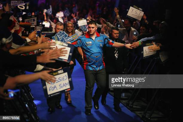 Daryl Gurney of Northern Ireland walks in prior to his first round match against Ronny Huybrechts of Belgium on day five of the 2018 William Hill PDC...