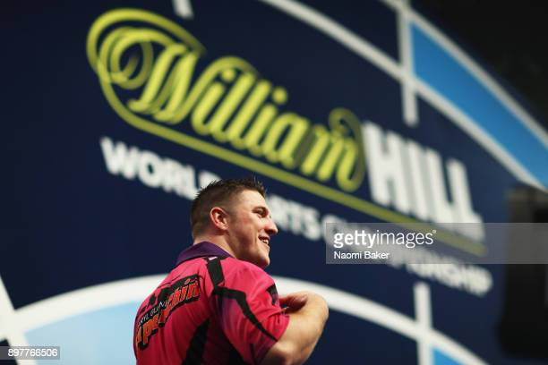 Daryl Gurney of Northern Ireland walks on stage ahead of his second round match against John Henderson of Scotland on day ten of the 2018 William...