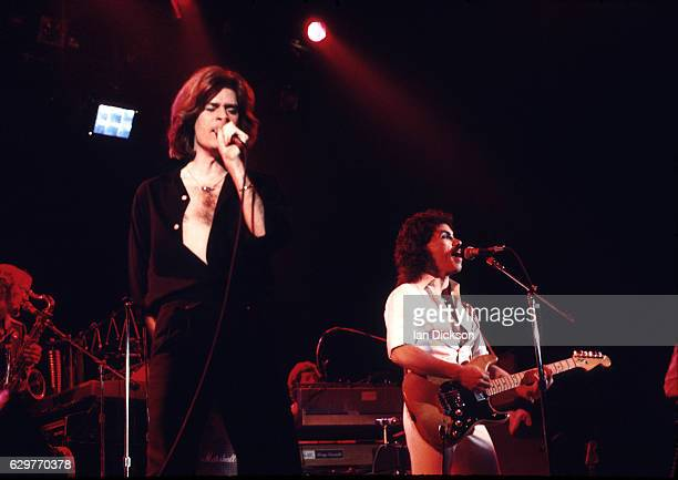 Daryl Hall and John Oates of Hall and Oates performing on stage at New Victoria Theatre London 26 May 1976