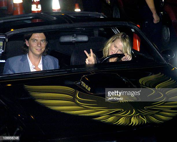 Daryl Hannah and guest during Kill Bill Vol 2 World Premiere Red Carpet at Arclight Cinerama Dome in Los Angeles California United States