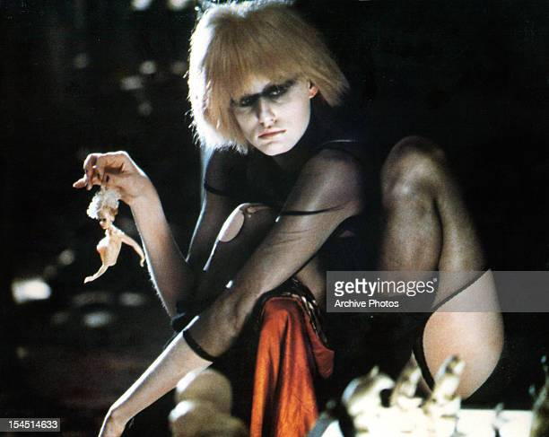 Daryl Hannah holds a mutilated doll by the hair in a scene from the film 'Blade Runner' 1982