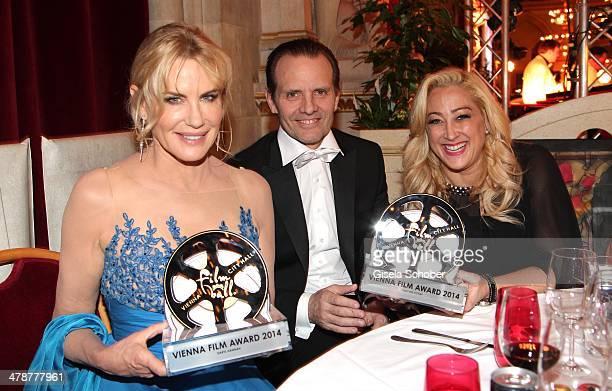 Daryl Hannah Michael Biehn Jennifer Blanc with award attend the 5th Filmball Vienna at City Hall on March 14 2014 in Vienna Austria