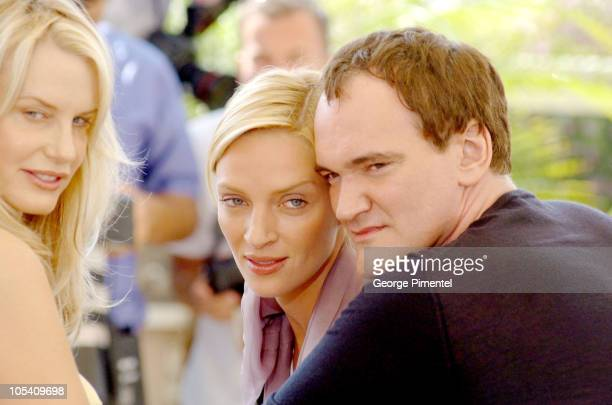 Daryl Hannah Uma Thurman and Quentin Tarantino during 2004 Cannes Film Festival Kill Bill Vol 2 Photocall at Palais Du Festival in Cannes France
